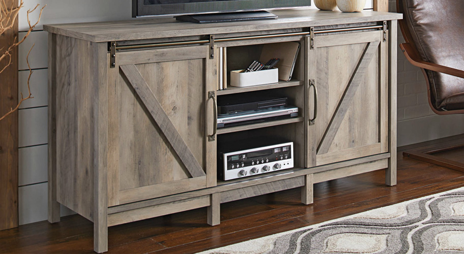 Farmhouse Flair. Get your hands on the latest trend in TV stands―barn doors that  give your room a rustic touch that's farmhouse cool.