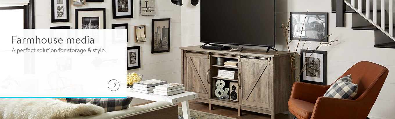 A farmhouse style tv stand with rustic barn doors. Links to where to shop rustic farmhouse media stands and decor.