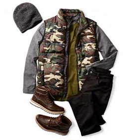Men's new arrivals. Camo vest with dark jeans, a beanie and outdoor boots.