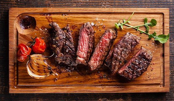 Grilled steak on carving board