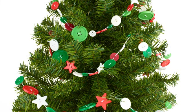 Red, white and green button garland on tree