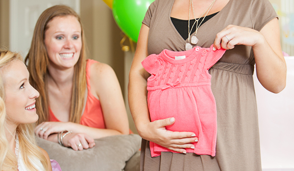 pregnant woman holding baby dress