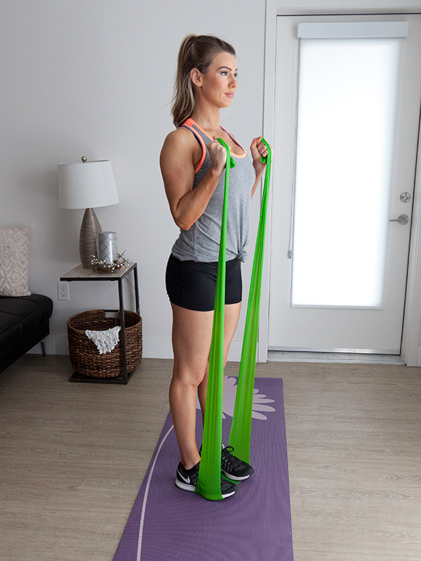 young busy mom working out at home