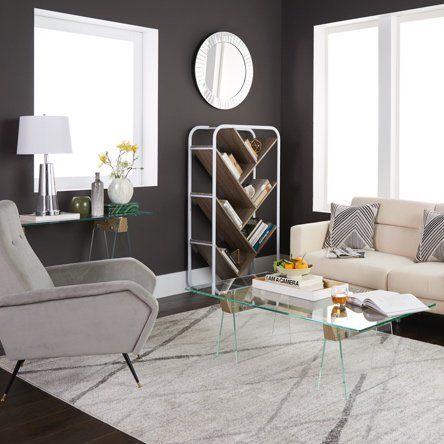 A modern living room with a gray modern accent chair, beige modern sofa, glass coffee table and modern geometric bookshelf.