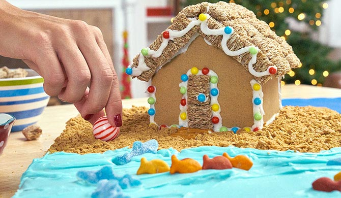 "Adding peppermint ""beach ball"" to beach gingerbread house"