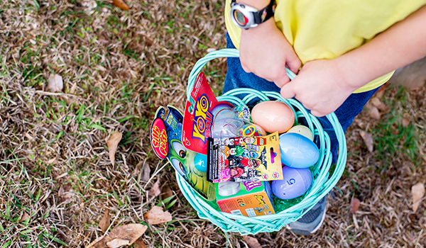 Easter egg scavenger hunt walmart child holding a full easter basket with plastic eggs candy and small toys negle Choice Image