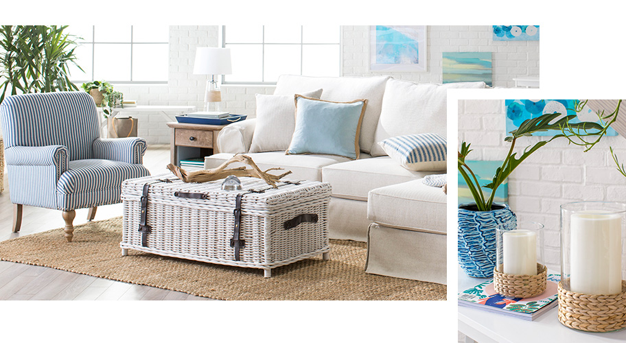 A modern coastal living room with natural materials and light blue color palette. Links to where to shop for coastal furniture and decor.