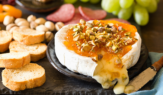 Oozing baked brie with apricot jam and pistachios