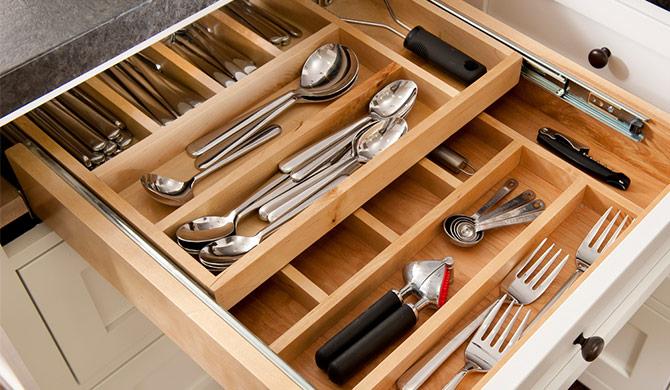 kitchen drawer full of neatly organized silverware