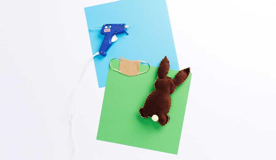step 7 glue ribbon straps to backpack shape
