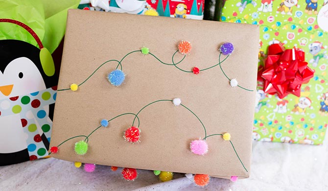 christmas light pom pom garland gift wrap how to