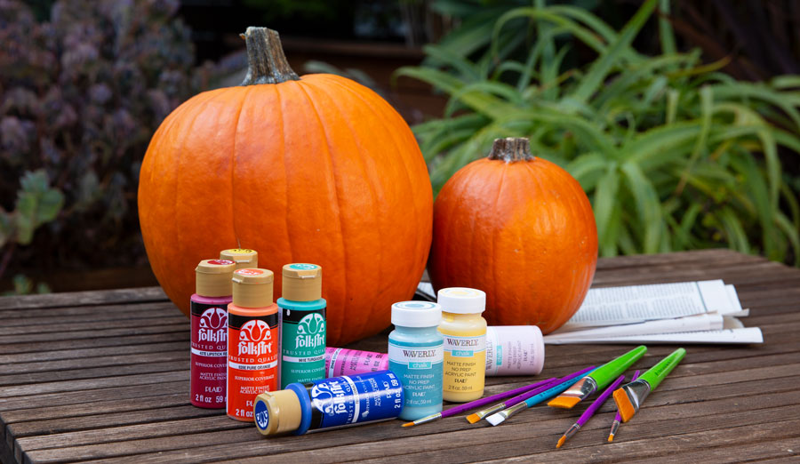 Supplies for painting plaid pumpkins