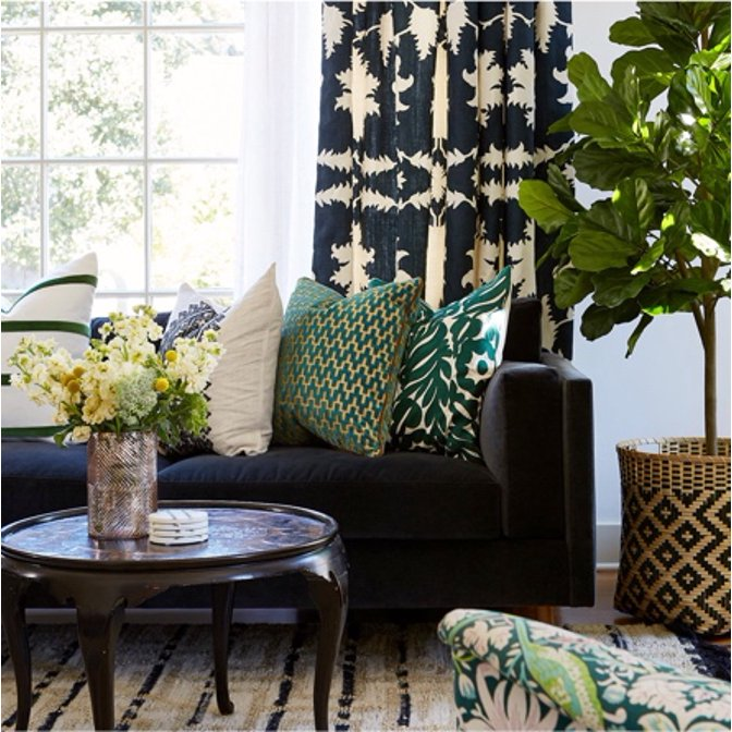 An eclectic living room designed by Carolyn Rebuffel of Workroom C with lots of dark colors and patterns