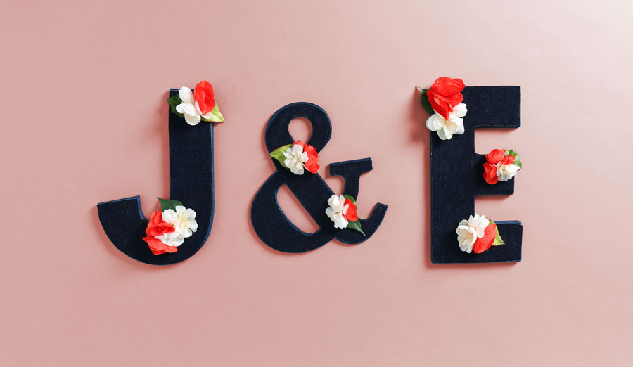 completed floral letter with strewn flowers