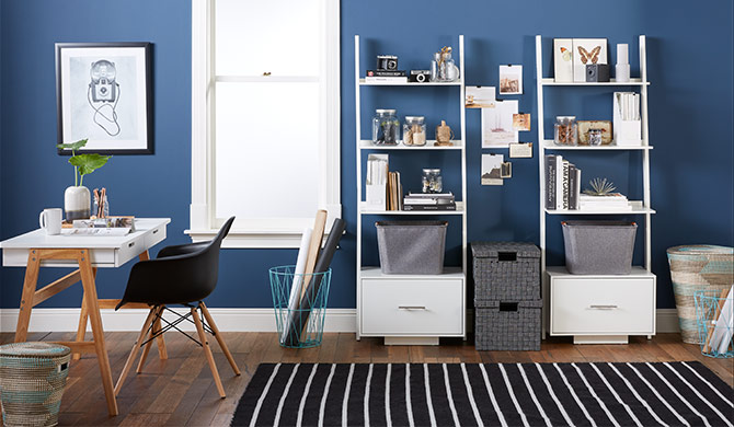 home office with desk and and white bookcases