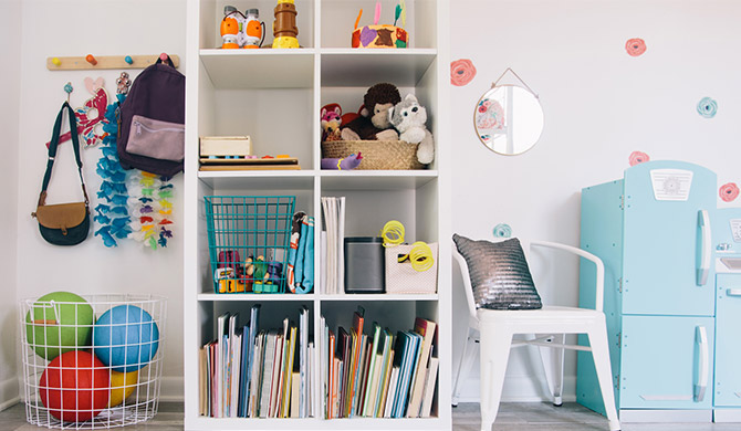 kids' playroom with a wire basket and cube storage