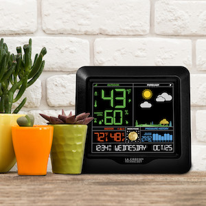 forecast station screen placed on kitchen counter