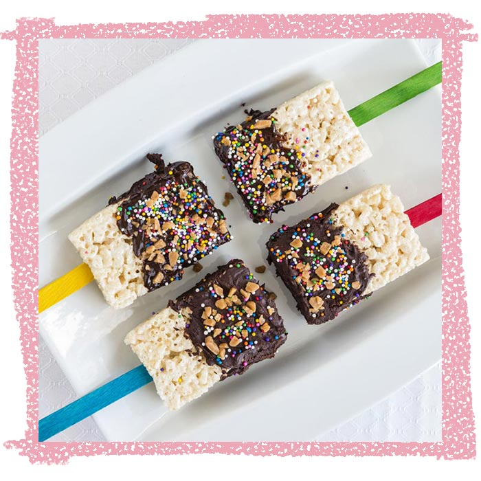 Frosting-dipped brown butter crispy rice treat pops