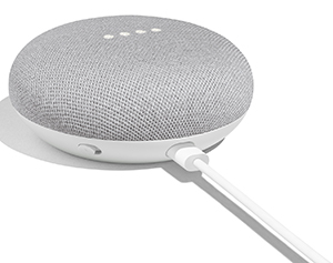 Google Home Mini chalk color - device has 4 white lights on top and a cable coming out of the back