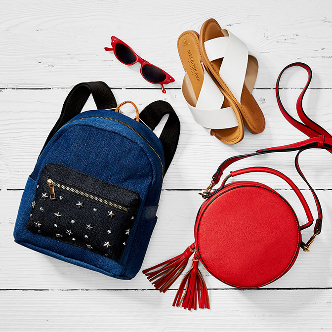 6652c0c57 Americana accessories. White sandals, a blue backpack, and a red purse.