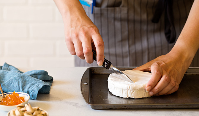 Score top of brie with knife before adding jam