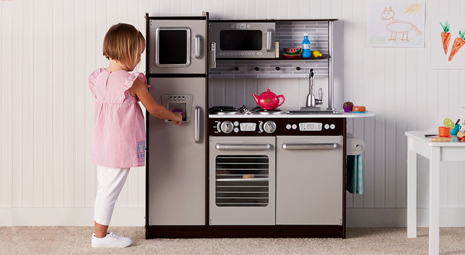 What's Cooking? Give your budding chefs a play kitchen & let their culinary imaginations run free.