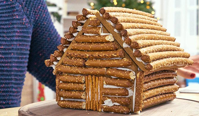 Assembled gingerbread log cabin ready for decorating