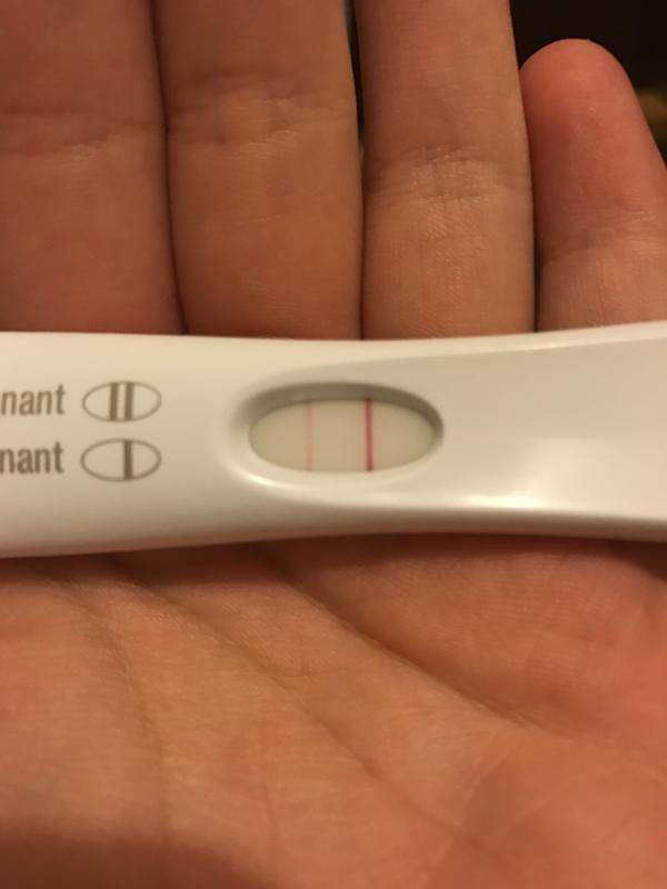 Pregnancy Test In Hand Pregnancy Symptoms