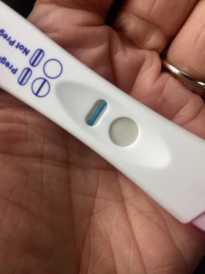 first response positive pregnancy test in hand